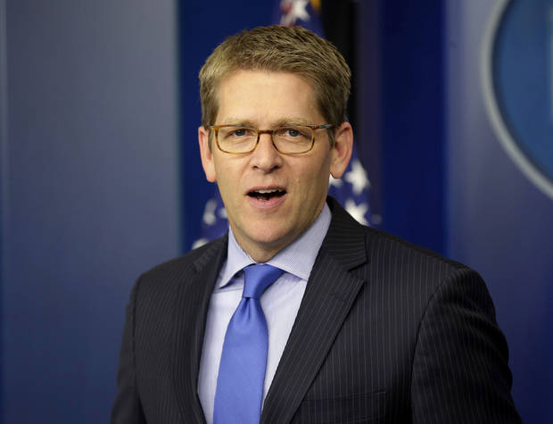 "In this Nov. 27, 2012, photo, White House press secretary Jay Carney speaks during his daily news briefing at the White House in Washington. Senate Democrats are deeply divided over whether cuts to popular benefit programs like Medicare and Medicaid should be part of a plan to address the nation�s financial problems, raising a big obstacle to an agreement to avoid the fiscal cliff, even if Republicans agree to raise taxes. Much of the focus during budget negotiations has centered on whether congressional Republicans would agree to raise taxes in exchange for spending cuts. ""It is the president's position that when we're talking about a broad, balanced approach to dealing with our fiscal challenges, that that includes dealing with entitlements,"" Carney said Tuesday. (AP Photo/Pablo Martinez Monsivais)"