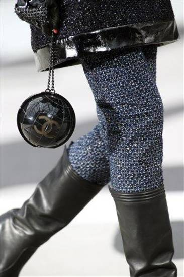 A model wears a creation by German fashion designer Karl Lagerfeld for Chanel's Fall/Winter 2013-2014 ready to wear collection, in Paris, Tuesday, March, 5, 2013. (AP Photo/Thibault Camus)