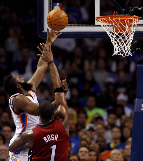 Oklahoma City's James Harden (13) shoots over Miami's Chris Bosh (1) during the NBA basketball game between the Miami Heat and the Oklahoma City Thunder at Chesapeake Energy Arena in Oklahoma City, Sunday, March 25, 2012. Photo by Sarah Phipps The Oklahoman