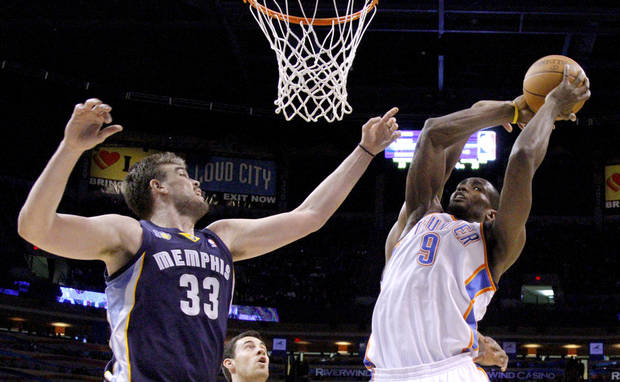 Oklahoma City's Serge Ibaka (9) shoot as Memphis' Marc Gasol (33) defends during the NBA basketball game between the Oklahoma City Thunder and the Memphis Grizzlies, Saturday, Jan. 8, 2011, at the Oklahoma City Arena. Photo by Sarah Phipps, The Oklahoman