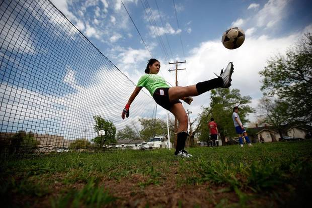 Sonia Abarzak practices in front of a temporary goal during soccer practice at an abandoned lot near Dove Science Academy in Oklahoma City, Tuesday, March 27, 2012. Photo by Sarah Phipps The Oklahoman
