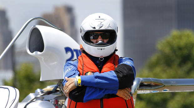 Jeff Bailey waits to takes a test run during the Oklahoma City Nationals professional drag boat racing on the Oklahoma River in Oklahoma City, Thursday, June 8, 2012. Photo By Steve Gooch, The Oklahoman