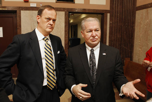 First Assistant District Attorney Scott Rowland and District Attorney David Prater discuss a bond hearing for Michael Elder Thursday at the Oklahoma County Courthouse in Oklahoma City. Elder is charged in the shooting death of his son-in-law. Photo by Paul B. Southerland, The Oklahoman <strong>PAUL B. SOUTHERLAND - PAUL B. SOUTHERLAND</strong>