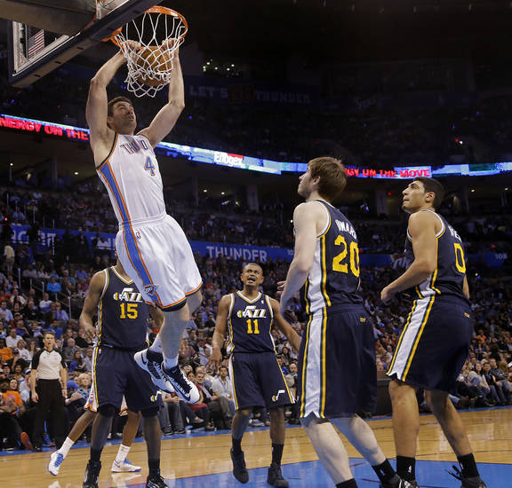 Oklahoma City Thunder's Nick Collison (4) dunks the ball over the Utah defense during the NBA basketball game between the Oklahoma City Thunder and the Utah Jazz at Chesapeake Energy Arena on Wednesday, March 13, 2013, in Oklahoma City, Okla. Photo by Chris Landsberger, The Oklahoman