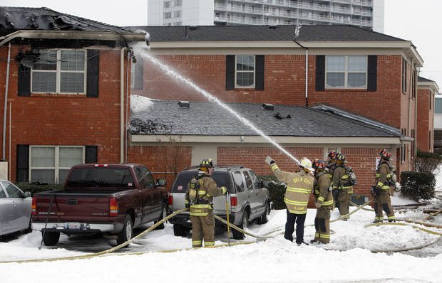 Oklahoma City firefighters work to put out the remnants of a fire at the Tara Condominiums at NW 62 and Brookline Ave. in Oklahoma City, Thursday, Feb. 3, 2011. Photo by Nate Billings, The Oklahoman