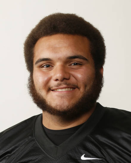 Carlos Freeman, Midwest City football player, poses for a mug shot during The Oklahoman's Fall High School Sports Photo Day in Oklahoma City, Wednesday, Aug. 15, 2012. Photo by Nate Billings, The Oklahoman