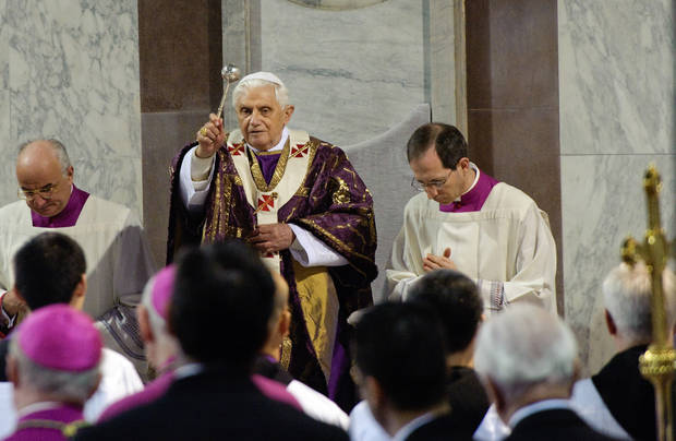 Pope Benedict XVI second from left background,  sprinkles holy water,  in Santa Sabina Basilica for Ash Wednesday prayer service, in Rome, Wednesday Feb. 25, 2009.  Ash Wednesday marks the beginning of Lent, a solemn period of 40 days of prayer and self-denial leading up to Easter. (AP Photo/Vincenzo Pinto, Pool)