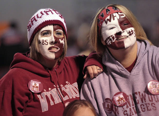 Savage player moms Shawna Keith and Crystal Knowles wear face aint as the Wayne Bulldogs play the Wynnewood Savages in District 5, Class A high school football on Friday, Oct. 28, 2011, in Wayne, Okla.    Photo by Steve Sisney, The Oklahoman