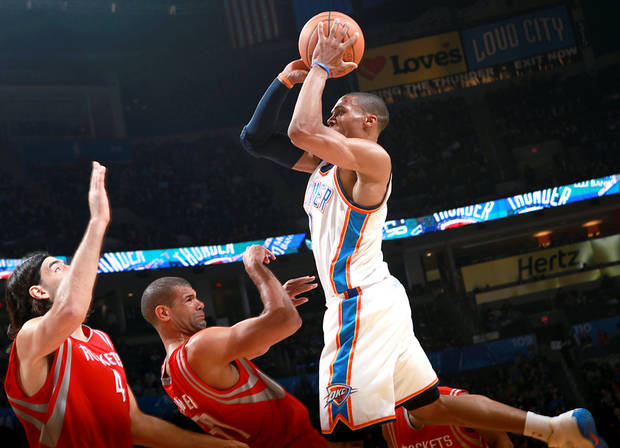 Oklahoma City's Russell Westbrook runs into pressure from Houston's Shane Battier and Luis Scola (left) during their NBA basketball game at the OKC Arena in downtown Oklahoma City on Wednesday, Nov. 17, 2010. Photo by John Clanton, The Oklahoman