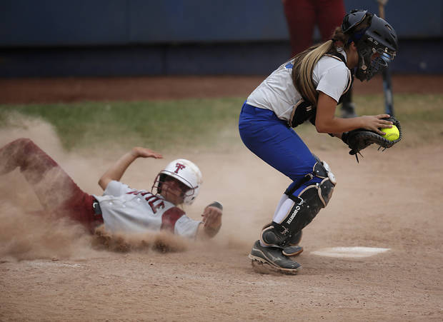 Tuttle's Shelby Carel (6) slides into during the 4A state softball semifinals game between Oolagah-Talala and Tuttle at ASA Hall of Fame Stadium in Oklahoma City, Okla., Friday, Oct. 12, 2012.  Photo by Garett Fisbeck, The Oklahoman