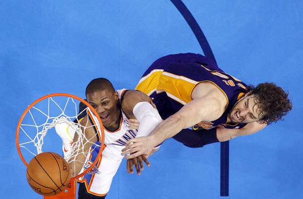 Oklahoma City's Russell Westbrook (0) shoots over Los Angeles' Pau Gasol (16) during Game 5 in the second round of the NBA playoffs between the Oklahoma City Thunder and the L.A. Lakers at Chesapeake Energy Arena in Oklahoma City, Monday, May 21, 2012. Photo by Sarah Phipps, The Oklahoman
