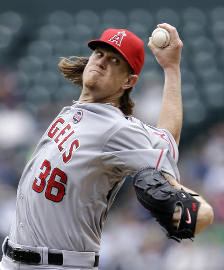 Los Angeles Angels starting pitcher Jered Weaver throws against the Seattle Mariners in the second inning of a baseball game on Sunday, Aug. 25, 2013, in Seattle. (AP Photo/Elaine Thompson)