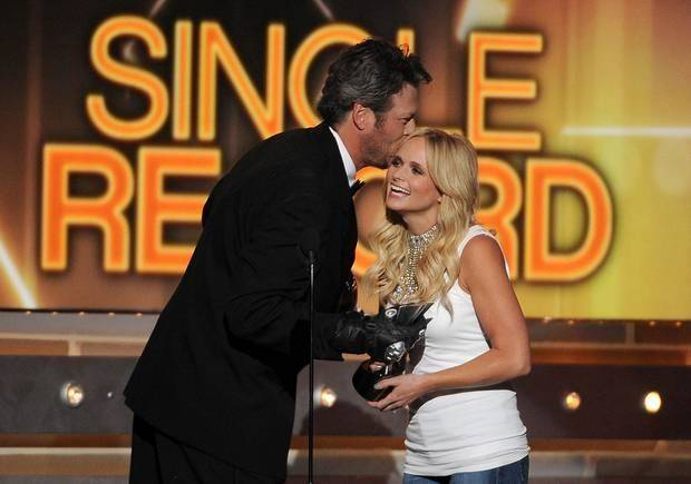 Host Blake Shelton, left, presents the single record of the year award to Miranda Lambert at the 49th annual Academy of Country Music Awards at the MGM Grand Garden Arena on Sunday, April 6, 2014, in Las Vegas. (AP)