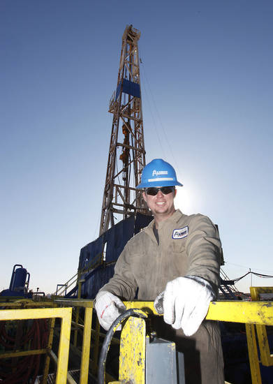 Derrickman Ryan Frayne works on mixing drilling mud at a SandRidge oil drilling rig near Medford, Thursday, October 18, 2012. This is for Oklahoma Inc. Photo By David McDaniel/The Oklahoman
