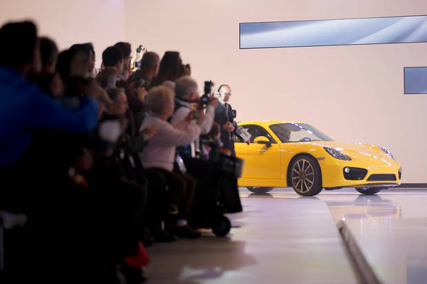 The new Porsche Cayman is introduced at the LA Auto Show in Los Angeles, Wednesday, Nov. 28, 2012. The annual Los Angeles Auto Show opened to the media Wednesday at the Los Angeles Convention Center. The show opens to the public on Friday, November 30. (AP Photo/Jae C. Hong)