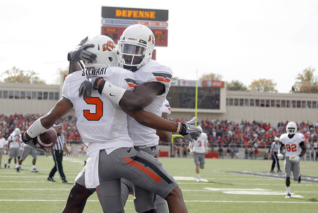 Oklahoma State Cowboys's Josh Stewart (5) and Justin Blackmon (81) celebrate a Stewart touchdown during a college football game between Texas Tech University (TTU) and Oklahoma State University (OSU) at Jones AT&T Stadium in Lubbock, Texas, Saturday, Nov. 12, 2011.  Photo by Sarah Phipps, The Oklahoman  ORG XMIT: KOD