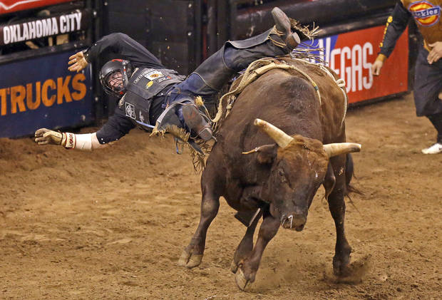 Brendon Clark falls off Groovy during the WinStar World Casino Invitational PBR bull riding event at Chesapeake Energy Arena in Oklahoma City, Saturday, Jan. 26, 2013. Photo by Bryan Terry, The Oklahoman