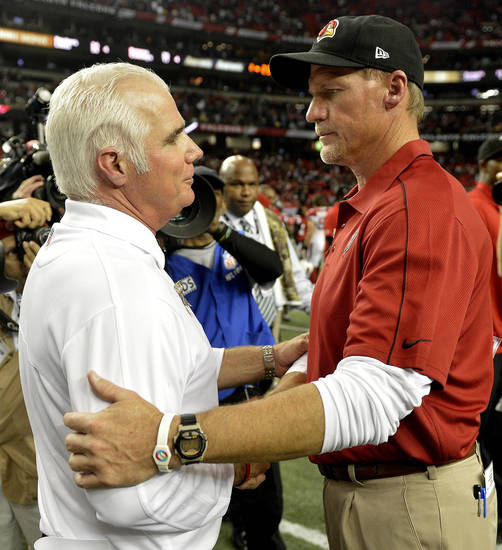 Atlanta Falcons head coach Mike Smith, left, speaks with Arizona Cardinals head coach Ken Whisenhunt after the second half of an NFL football game Sunday, Nov. 18, 2012, in Atlanta. The Falcons won 23-19. (AP Photo/Rich Addicks)