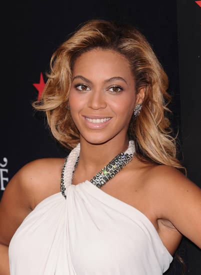 "FILE - In this Sept. 22, 2011 file photo, singer Beyonce Knowles makes an appearance at Macy's Herald Square to promote her new fragrance 'Pulse' in New York. People magazine is naming Beyonce as the World's Most Beautiful Woman for 2012. The 30-year-old singer tops the magazine's annual list of the ""World's Most Beautiful"" in a special double issue. The announcement was made Wednesday, April 25, 2012. (AP Photo/Peter Kramer) ORG XMIT: NY116"