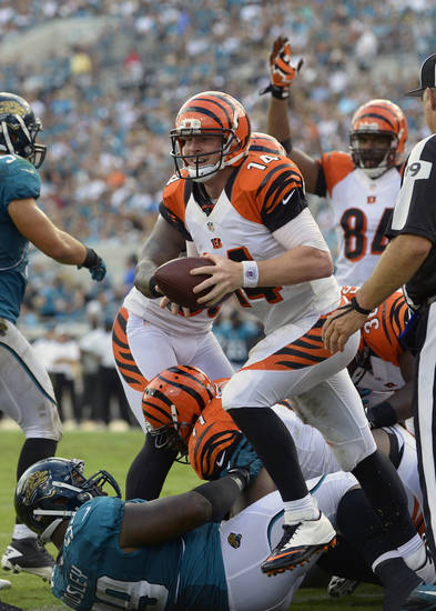Cincinnati Bengals quarterback Andy Dalton jumps up after scoring a touchdown against the Jacksonville Jaguars on a quarterback sneak for one-yard during the first half of an NFL football game, Sunday, Sept. 30, 2012, in Jacksonville, Fla. (AP Photo/Phelan M. Ebenhack)