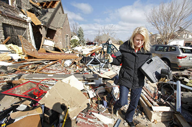 Karen Arms tries to find items to salvage from her damaged home in the Oak Tree addition on Wednesday, Feb. 11, 2009, after a tornado hit the area on Tuesday in Edmond, Okla.  PHOTO BY CHRIS LANDSBERGER, THE OKLAHOMAN