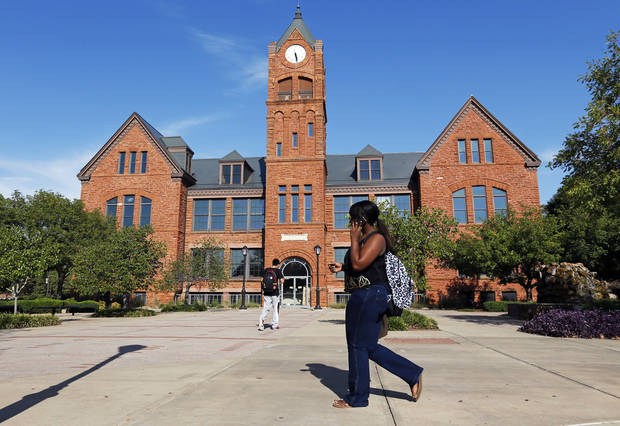 People walk past the west side of Old North on the campus of the University of Central Oklahoma in Edmond. Photo by Nate Billings, The Oklahoman archives