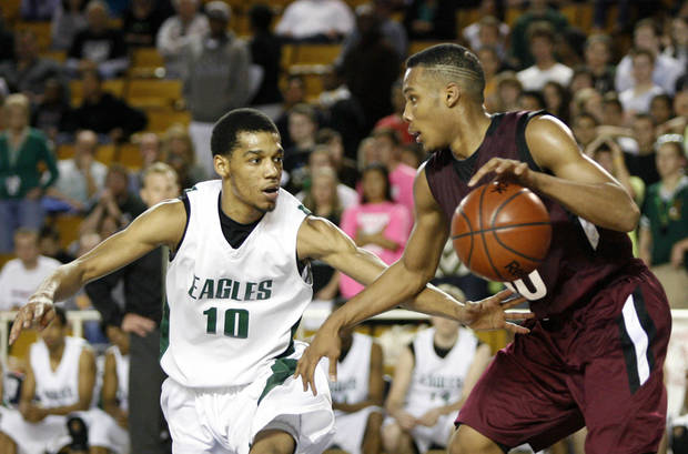 Edison&#039;s Ehron Ponds (left) defends Edmond Memorial&#039;s Jordan Woodard  during a basketball game at Oral Roberts University in Tulsa on Friday, March 9, 2012. MATT BARNARD/Tulsa World