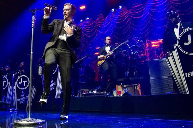 "In this May 5, 2013 file photo, Justin Timberlake performs at the MasterCard Priceless Premieres concert in New York. Nielsen Entertainment announced late Tuesday, Jan. 7, 2014, that Timberlake's ""The 20/20 Experience"" was the year's top-selling album with 2.4 million units sold. (AP)"