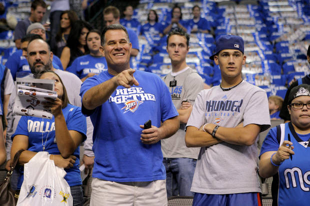 Jim and Chad Jenne of Moore, Okla., watch before game 1 of the Western Conference Finals in the NBA basketball playoffs between the Dallas Mavericks and the Oklahoma City Thunder at American Airlines Center in Dallas, Tuesday, May 17, 2011. Photo by Bryan Terry, The Oklahoman