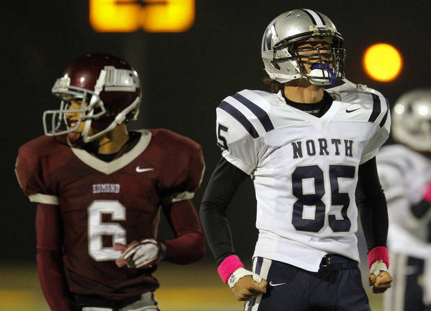 Edmond North's Nick Sandini celebrates a sack in front of Edmond Memorial's Bryce Robinson during the high school football game between Edmond North and Edmond Memorial at Wantland Stadium in Edmond, Okla., Friday, Sept. 16, 2011. Photo by Sarah Phipps, The Oklahoman