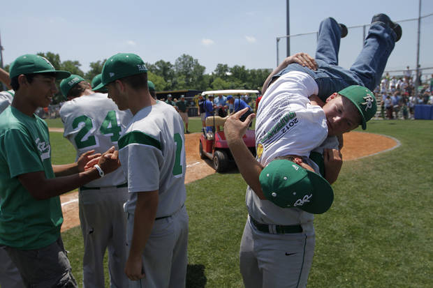 Colby Chandler (10) holds up team manager, Efrom Parra, after winning the Class A State Championship against Amber-Pocasset at Dolese Park in Oklahoma City, Saturday, May 5, 2012.  Photo by Garett Fisbeck, For The Oklahoman
