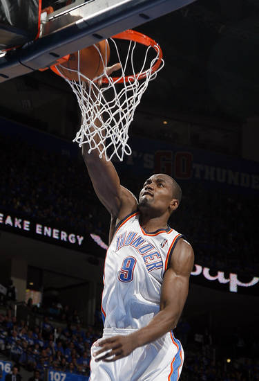 Oklahoma City&#039;s Serge Ibaka (9) dunks the ball during game one of the first round in the NBA playoffs between the Oklahoma City Thunder and the Dallas Mavericks at Chesapeake Energy Arena in Oklahoma City, Saturday, April 28, 2012. Photo by Sarah Phipps, The Oklahoman