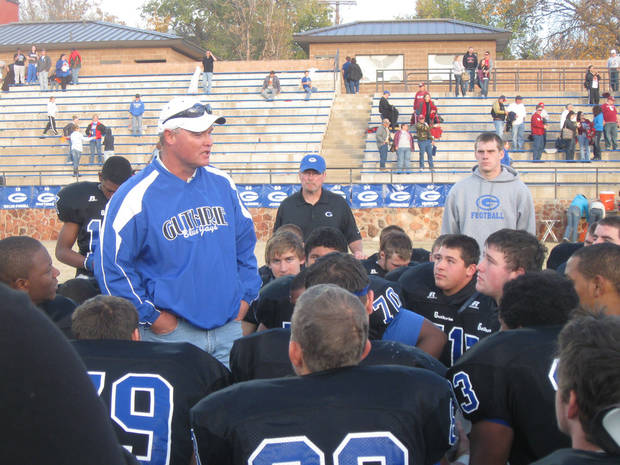 Suspended Guthrie coach Rafe Watkins talks to the team after Guthrie's first-round playoff game against Durant from in the stands on Saturday, Nov. 12 at Jelsma Stadium in Guthrie. Clint Simek is pictured top right, wearing gray. PHOTO BY JASON KERSEY, THE OKLAHOMAN