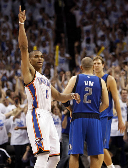 Oklahoma City's Russell Westbrook (0) reacts in front of Dallas' Jason Kidd (2) and Dirk Nowitzki (41) at the end of Game 2 of the first round in the NBA basketball  playoffs between the Oklahoma City Thunder and the Dallas Mavericks at Chesapeake Energy Arena in Oklahoma City, Monday, April 30, 2012.  Oklahoma City won, 102-99. Photo by Nate Billings, The Oklahoman