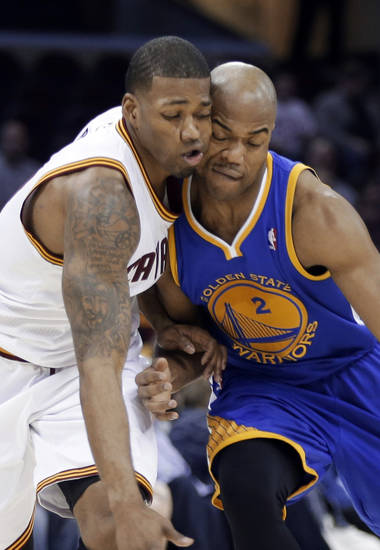 Golden State Warriors' Jarrett Jack (2) collides with Cleveland Cavaliers' Alonzo Gee on a drive in the first quarter of an NBA basketball game Tuesday, Jan. 29, 2013, in Cleveland. (AP Photo/Mark Duncan)