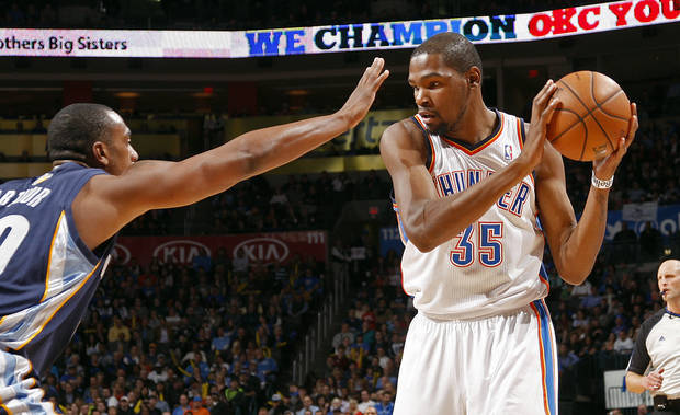 Oklahoma City&#039;s Kevin Durant (35) looks to get past Memphis&#039; Darrell Arthur (00) during the NBA basketball game between the Oklahoma City Thunder and the Memphis Grizzlies at the Chesapeake Energy Arena in Oklahoma City,  Thursday, Jan. 31, 2013.Photo by Sarah Phipps, The Oklahoman