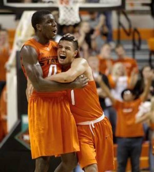 Oklahoma State's Cezar Guerrero (1) and Oklahoma State's Jean-Paul Olukemi (0) celebrate during an NCAA college basketball game between the Oklahoma State University Cowboys (OSU) and the University of Texas-San Antonio Roadrunners at Gallagher-Iba Arena in Stillwater, Okla., Wednesday, Nov. 16, 2011. Photo by Bryan Terry, The Oklahoman ORG XMIT: KOD