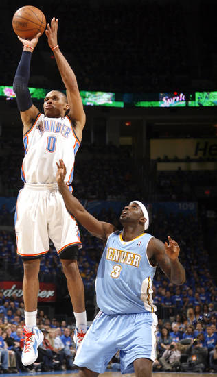 Oklahoma City's Russell Westbrook (0) shoots in over Denver's Ty Lawson (3) during the first round NBA basketball playoff game between the Oklahoma City Thunder and the Denver Nuggets on Wednesday, April 20, 2011, at the Oklahoma City Arena. Photo by Sarah Phipps, The Oklahoman
