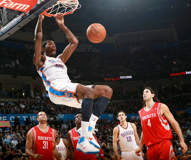Oklahoma City's Kevin Durant puts up a slam dunk against Houston during their NBA basketball game at the OKC Arena in downtown Oklahoma City on Wednesday, Nov. 17, 2010. Photo by John Clanton, The Oklahoman
