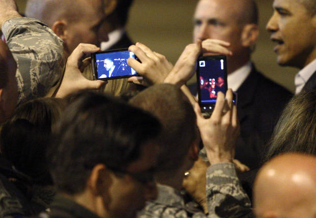 A group of military and civilian personal take photos of President Barack Obama at Tinker Air Force Base in Midwest City, Wednesday, March 21, 2012. President Obama is in town for a visit to Cushing, Okla., on Thursday. Photo by Bryan Terry, The Oklahoman
