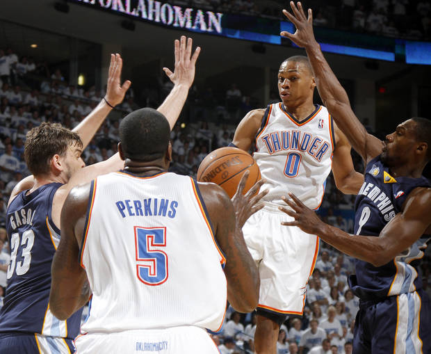 Oklahoma City's Russell Westbrook (0) passes the ball from between Marc Gasol (33) of Memphis and Tony Allen (9) during game five of the Western Conference semifinals between the Memphis Grizzlies and the Oklahoma City Thunder in the NBA basketball playoffs at Oklahoma City Arena in Oklahoma City, Wednesday, May 11, 2011. Photo by Bryan Terry, The Oklahoman