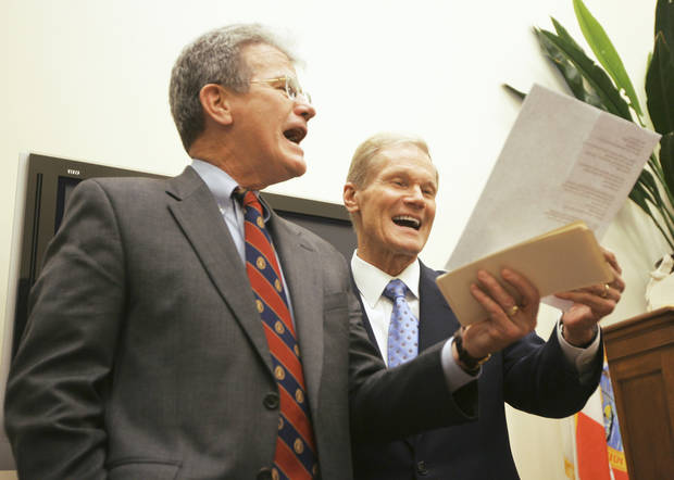 "Sen. Tom Coburn, R-Muskogee, left, sings Elton John's ""Rocket Man"" with Sen. Bill Nelson, D-Fla., on Wednesday in Washington. AP PHOTO"