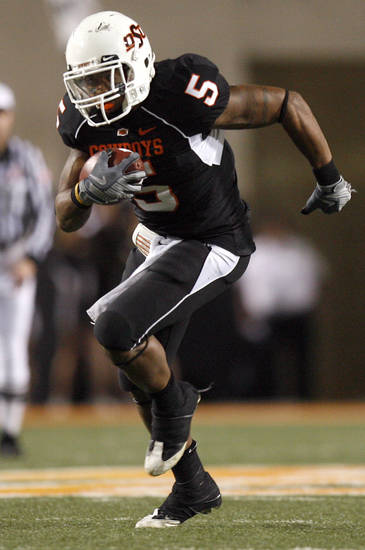OSU's Keith Toston (5) runs on the way to a touchdown during the college football game between Oklahoma State University (OSU) and the University of Colorado (CU) at Boone Pickens Stadium in Stillwater, Okla., Thursday, Nov. 19, 2009. Photo by Sarah Phipps, The Oklahoman