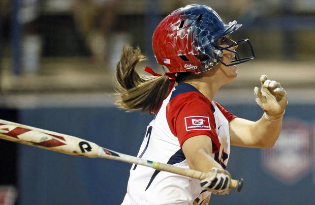 Lauren Gibson (27) of the United States hits a two-run home run in the sixth inning during a game between Team USA and Canada in the World Cup of Softball at ASA Hall of Fame Stadium in Oklahoma City, Thursday, July 11, 2013. Team USA won 7-0 in 6 innings. Photo by Nate Billings, The Oklahoman