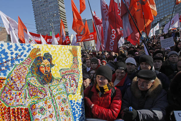 Opposition protesters with a placard depicting Czar Ivan The Terrible gathered during a rally in Moscow, Russia, Saturday, March 10, 2012. The demonstrators gathered in central Moscow to protest electoral fraud. Saturday's rally is widely seen as evidence of whether the opposition is able to maintain its strength after Vladimir Putin on Sunday won a return to the Kremlin. (AP Photo/Ivan Sekretarev)