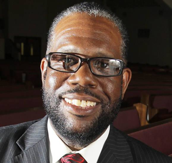 Rev. Ray Douglas poses for a photo at the Greater Mount Olive Baptist Church in Oklahoma City, Friday, June 29, 2012.  Photo by Garett Fisbeck, The Oklahoman