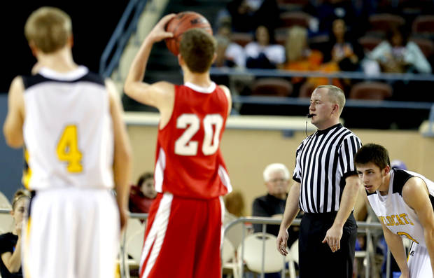 Jason Frantz officiates a free throw during the Class B Boys semifinal game of the state high school basketball tournament between Big Pasture and Arnett at the State Fair Arena., Friday, March 1, 2013. Photo by Sarah Phipps, The Oklahoman