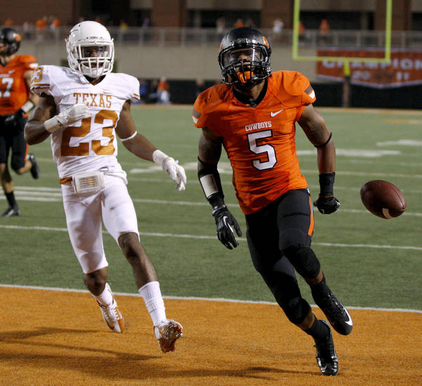 Oklahoma State's Josh Stewart (5) celebrates a touchdown beside Texas' Carrington Byndom (23) during a college football game between Oklahoma State University (OSU) and the University of Texas (UT) at Boone Pickens Stadium in Stillwater, Okla., Saturday, Sept. 29, 2012. Oklahoma State lost 41-36. Photo by Bryan Terry, The Oklahoman