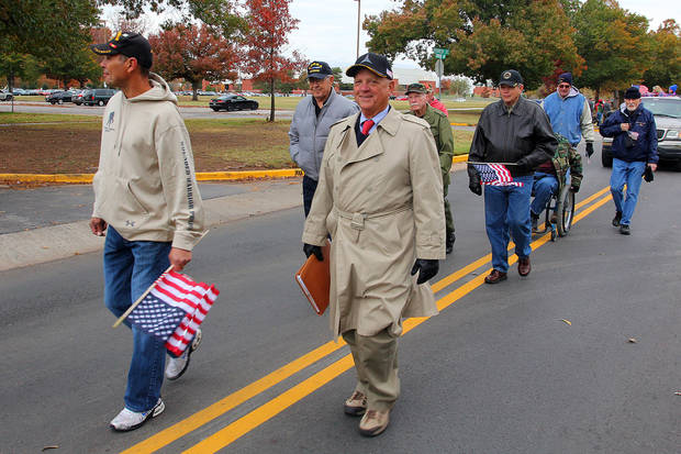 Veterans walk in the Veterans Day parade in Norman Sunday. PHOTO BY HUGH SCOTT FOR THE OKLAHOMAN ORG XMIT: KOD