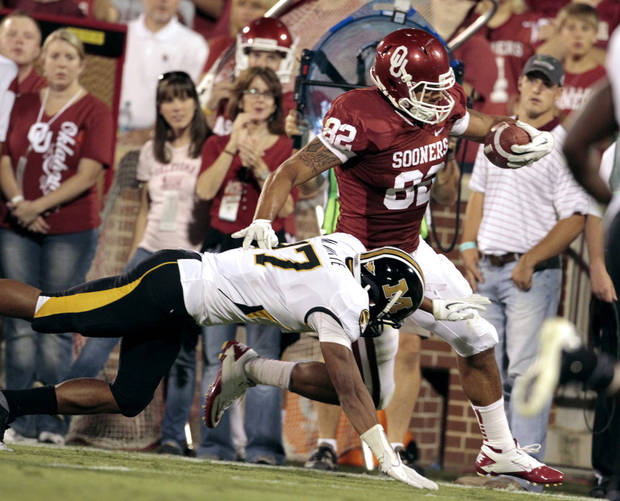 Oklahoma's Dominique Whaley (8) is run out of bounds by Missouri's Randy Ponder (7) on Saturday. Photo by Steve Sisney, The Oklahoman